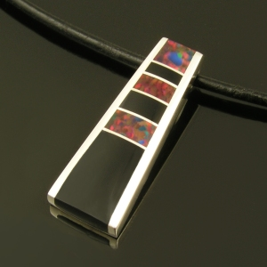 Sterling silver pendant inlaid with Gilson created opal and onyx