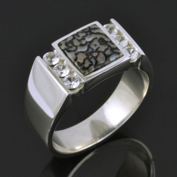 Gray dinosaur bone and white sapphire ring in sterling silver.