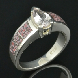 Pink dinosaur bone ring with white sapphire set in sterling silver.