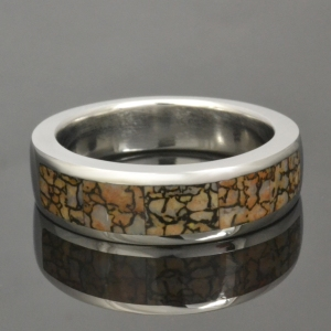 Tan dinosaur bone ring in cobalt chrome.