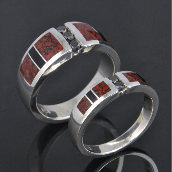 Dinosaur bone wedding ring set with black diamonds.