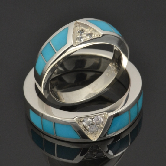 Turquoise wedding ring set with white sapphires by Hileman.